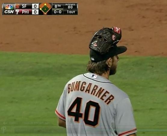 Giants-Bumgarner-Glove On Head-2014-07-23