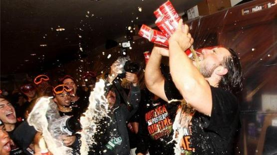 Giants-2014-NLDS-Game 4-Celebration-Bumgarner-Five Beers-4A