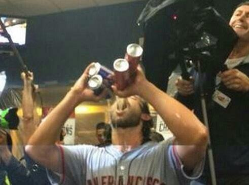 Giants-2014-Wild Card-Celebration-Bumgarner-Four Beers-Closeup